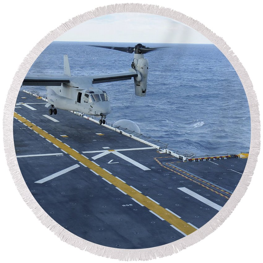 Uss Iwo Jima Round Beach Towel featuring the photograph An Mv-22 Osprey Lands Aboard by Stocktrek Images