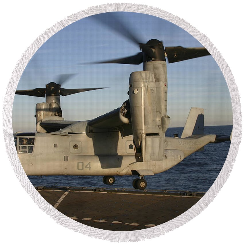 No People Round Beach Towel featuring the photograph An Mv-22 Osprey Lands Aboard Usns by Stocktrek Images
