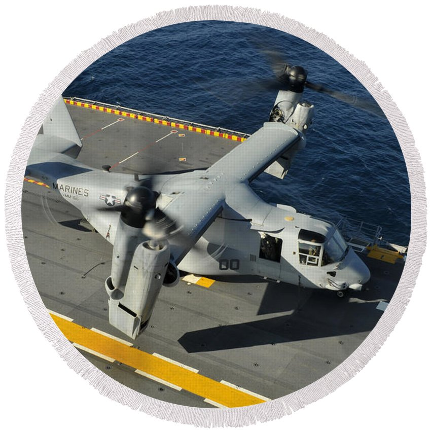 No People Round Beach Towel featuring the photograph An Mv-22 Osprey Lands Aboard Uss by Stocktrek Images