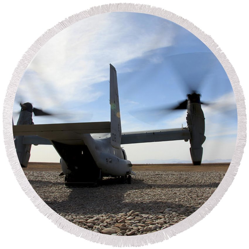 Mv-22 Round Beach Towel featuring the photograph An Mv-22 Osprey Sits Outside A Forward by Stocktrek Images
