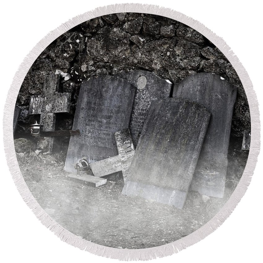 Cemetery Round Beach Towel featuring the photograph An Old Cemetery With Grave Stones And Fog by Joana Kruse