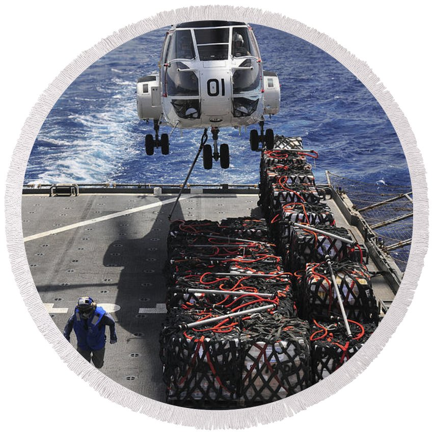 Military Sealift Command Round Beach Towel featuring the photograph An Sa-330j Puma Helicopter Picking by Stocktrek Images