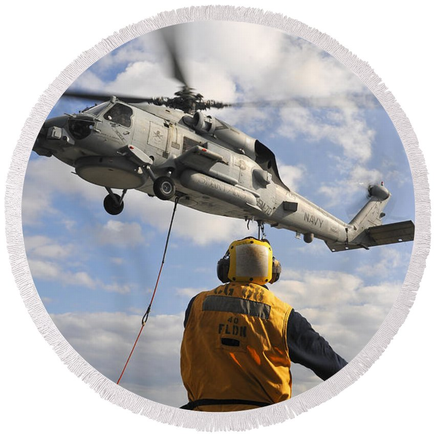 Uss Anzio Round Beach Towel featuring the photograph An Sh-60b Sea Hawk Helicopter Releases by Stocktrek Images