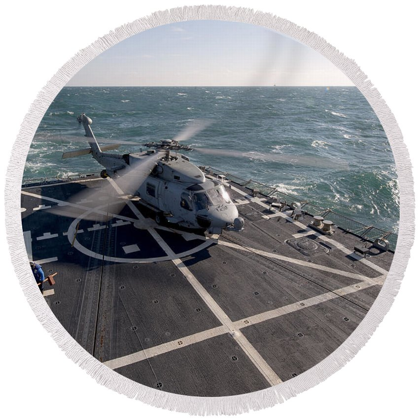 Military Round Beach Towel featuring the photograph An Sh-60b Sea Hawk On The Flight Deck by Stocktrek Images