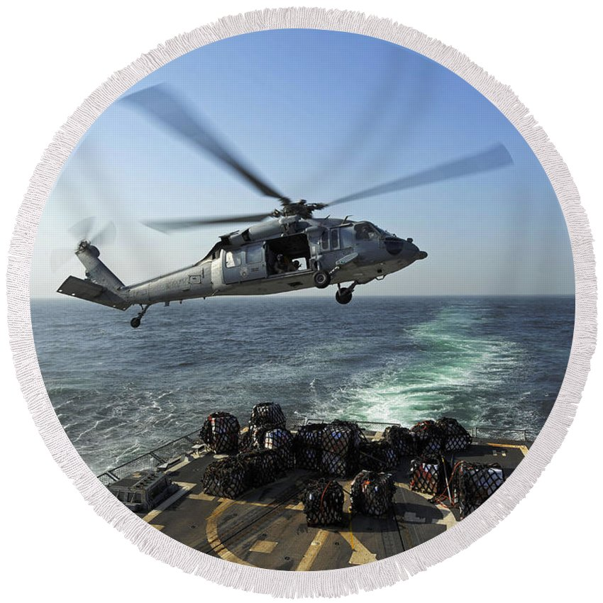 Military Round Beach Towel featuring the photograph An Sh-60r Sea Hawk Delivers Pallets by Stocktrek Images