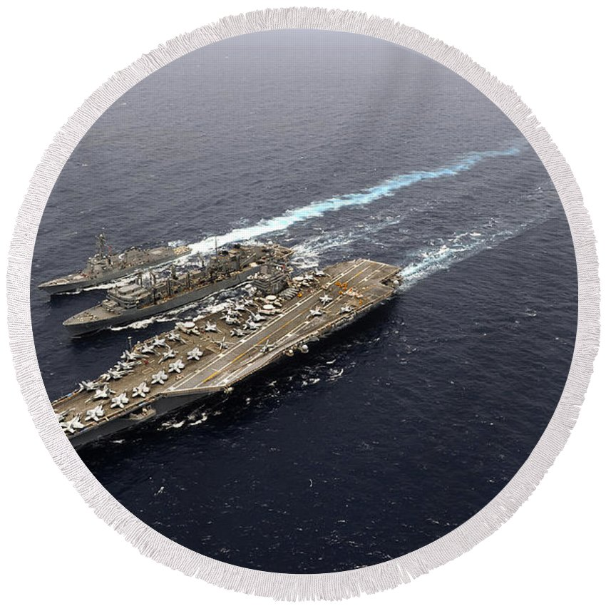 Carrier Strike Group Round Beach Towel featuring the photograph An Underway Replenishment With Ships by Stocktrek Images