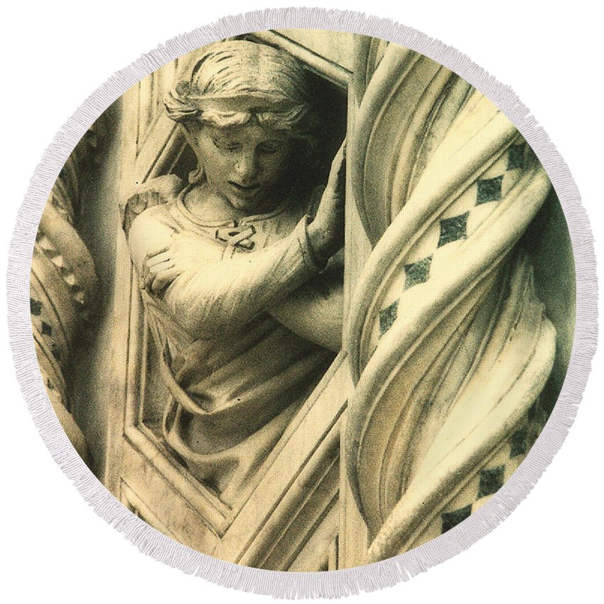 This Angel Graces The Outer Wall Of Basilica Di Santa Maria Del Fiore In Florence Italy. Round Beach Towel featuring the photograph Angel Of The Basilica by Diana Haronis