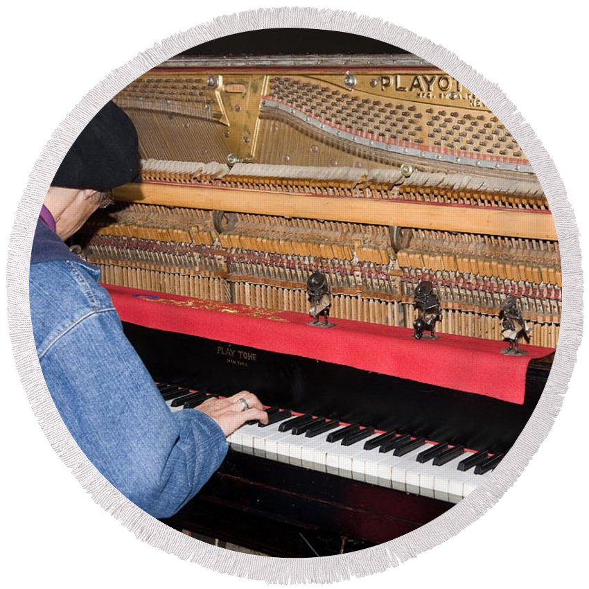 Man Playing 1909 Playtone Piano Converted From Player Style Round Beach Towel featuring the photograph Antique Playtone Piano by Sally Weigand