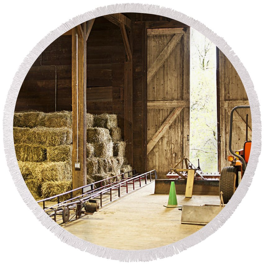 Barn Round Beach Towel featuring the photograph Barn With Hay Bales And Farm Equipment by Elena Elisseeva
