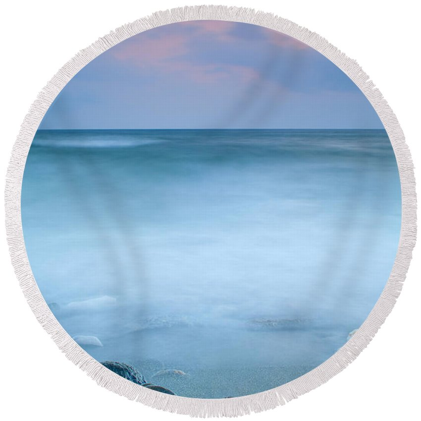 Seascape Round Beach Towel featuring the photograph Black Stones by Guido Montanes Castillo