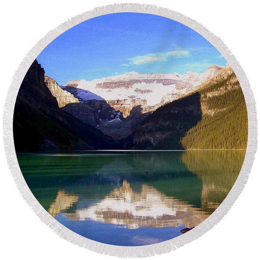Lake Louise Round Beach Towel featuring the photograph Butterfly Phenomenon At Lake Louise by Karen Wiles