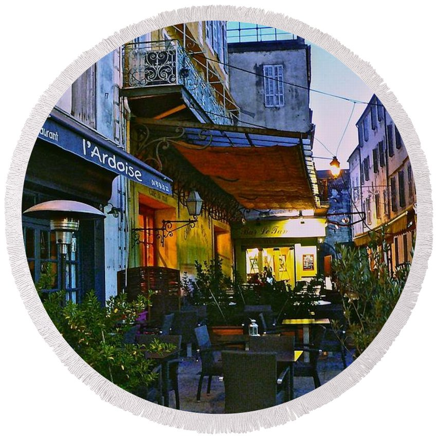 Cafe Terrace On The Place Du Forum Round Beach Towel featuring the photograph Cafe Terrace On The Place Du Forum by Eric Tressler
