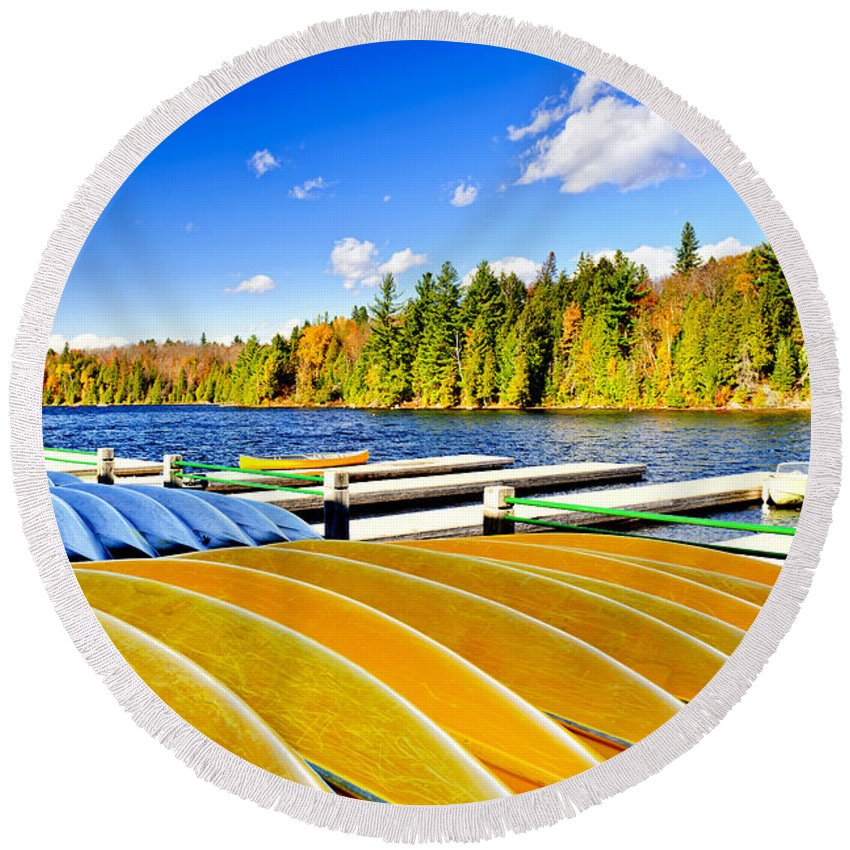 Canoes Round Beach Towel featuring the photograph Canoes On Autumn Lake by Elena Elisseeva