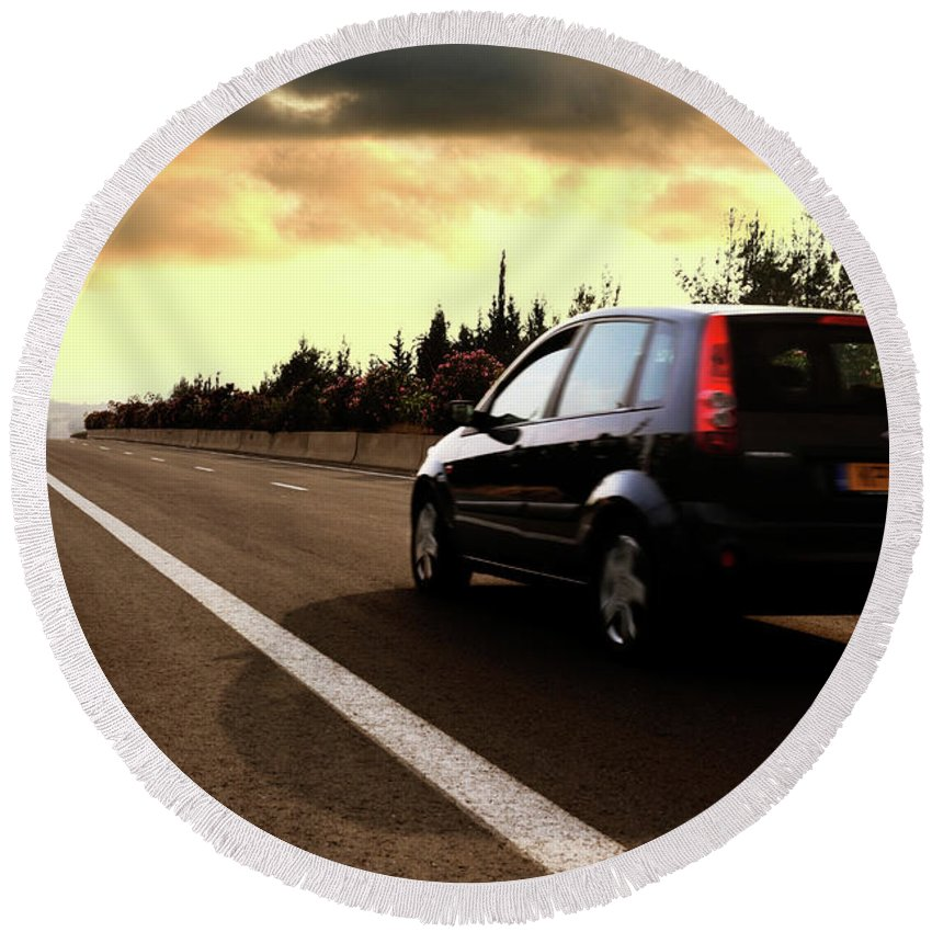 Car Round Beach Towel featuring the photograph Car On The Road During Sunset by Maxim Images Prints