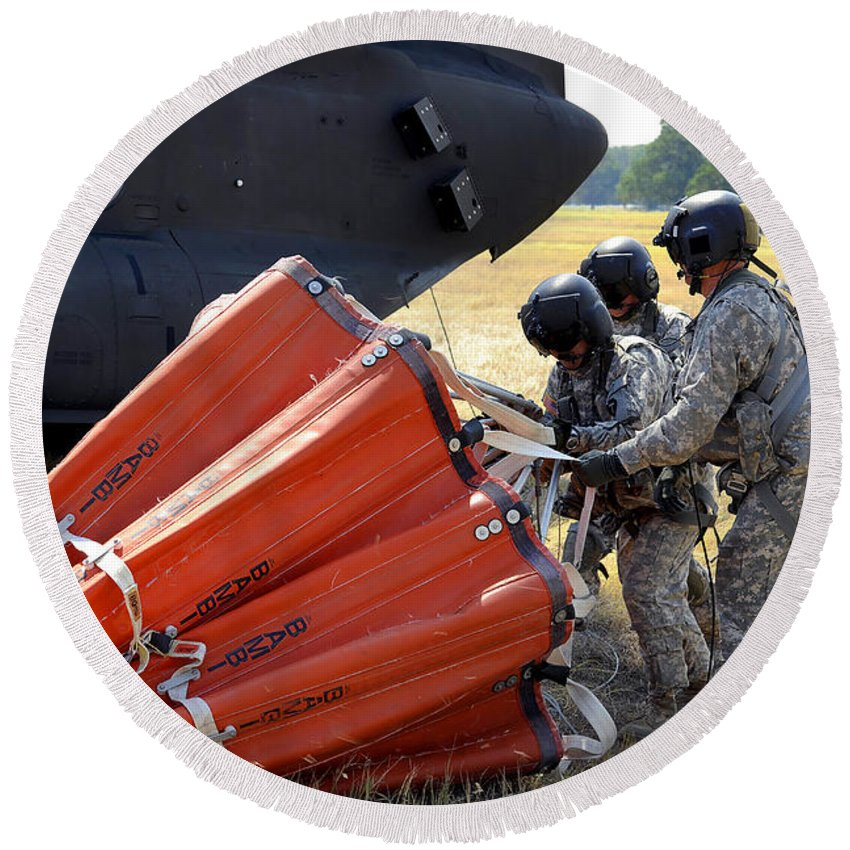 Preparation Round Beach Towel featuring the photograph Ch-47 Chinook Helicopter Crew Prepare by Stocktrek Images