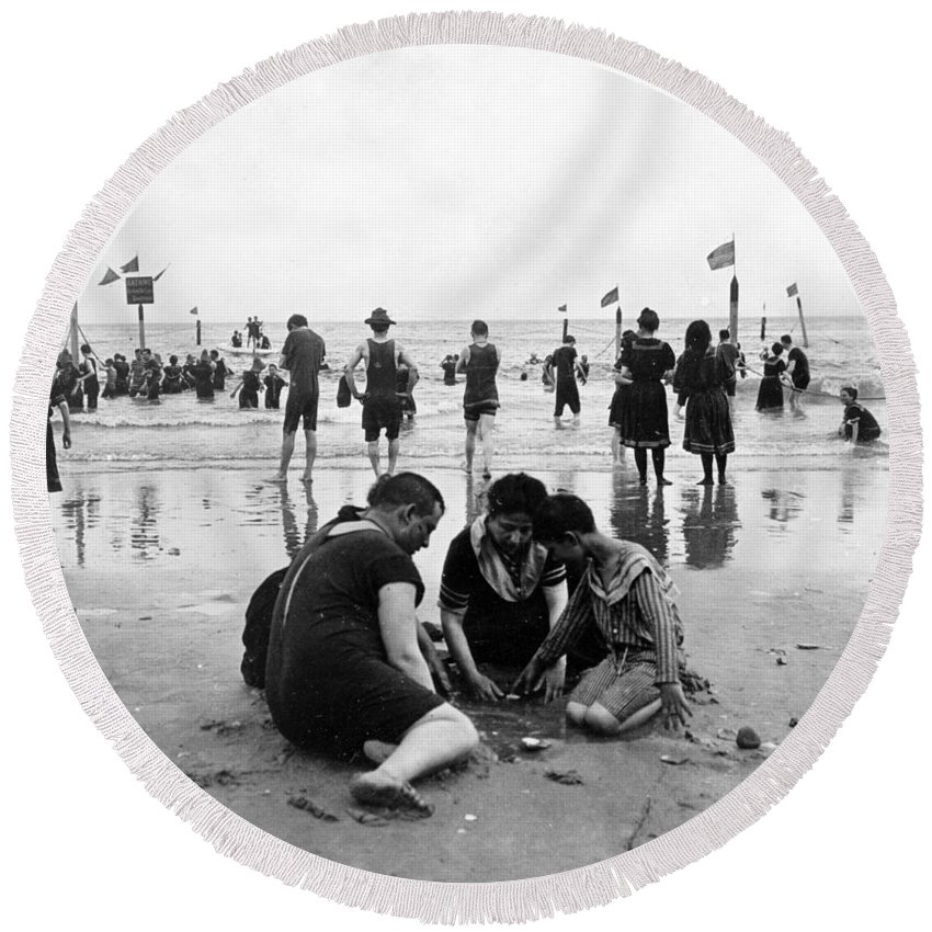 coney Island Round Beach Towel featuring the photograph Coney Island Beach Goers - C 1906 by International Images