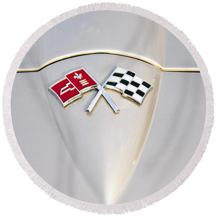 Chevrolet Round Beach Towel featuring the photograph Corvette Emblem by Glenn Gordon