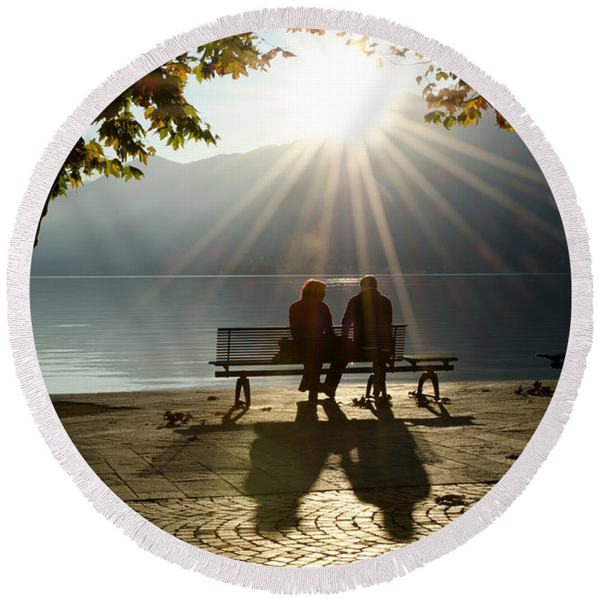 Couple Round Beach Towel featuring the photograph Couple On A Bench by Mats Silvan