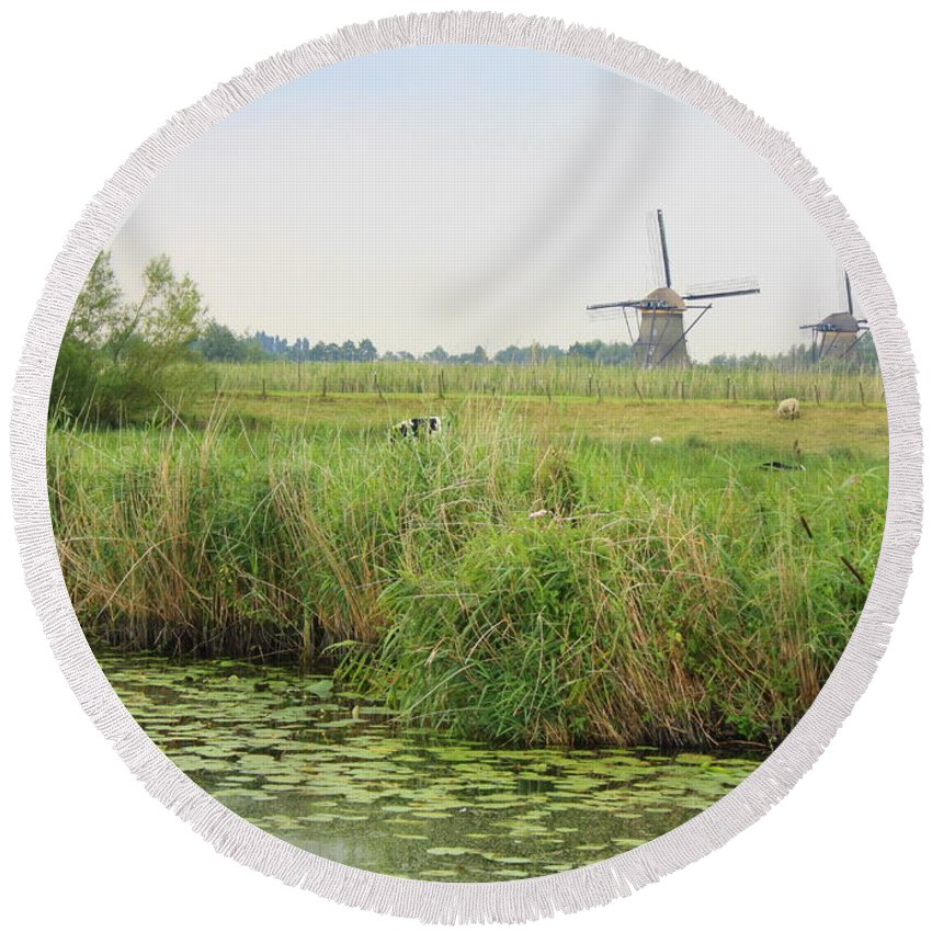 Dutch Landscape Round Beach Towel featuring the photograph Dutch Landscape With Windmills And Cows by Carol Groenen