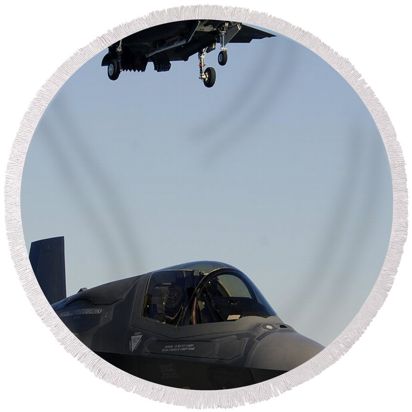 Aerospace Round Beach Towel featuring the photograph F-35b Lighnting II Variants Land Aboard by Stocktrek Images