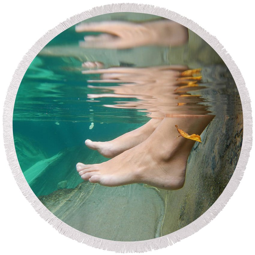 Feet Round Beach Towel featuring the photograph Feet Under The Water by Mats Silvan