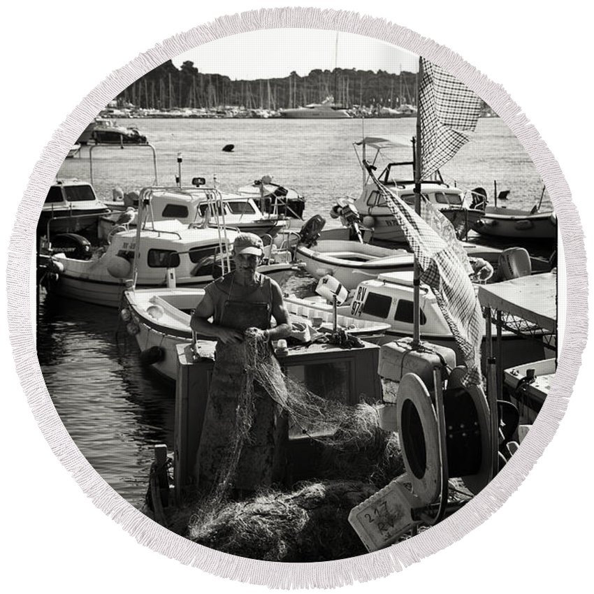 Fisherman Round Beach Towel featuring the photograph Fisherman by Madeline Ellis