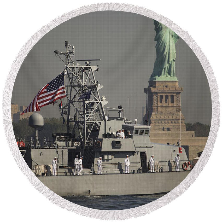 Liberty Island Round Beach Towel featuring the photograph Fleet Week Vessels Pass By The Statue by Stocktrek Images