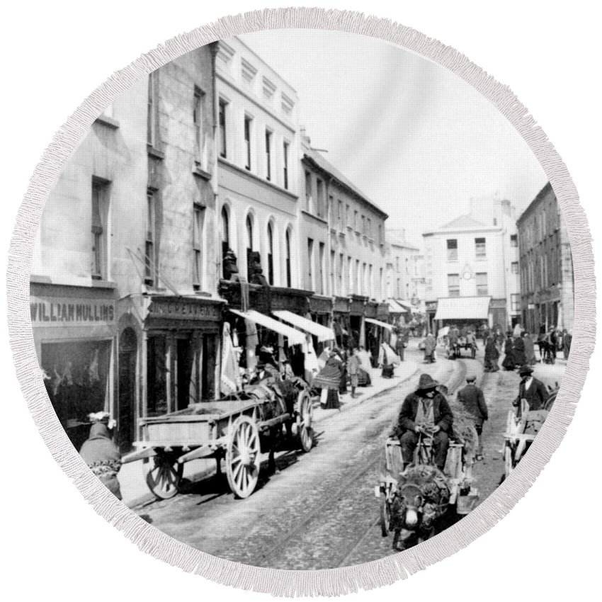 high Street Round Beach Towel featuring the photograph Galway Ireland - High Street - C 1901 by International Images
