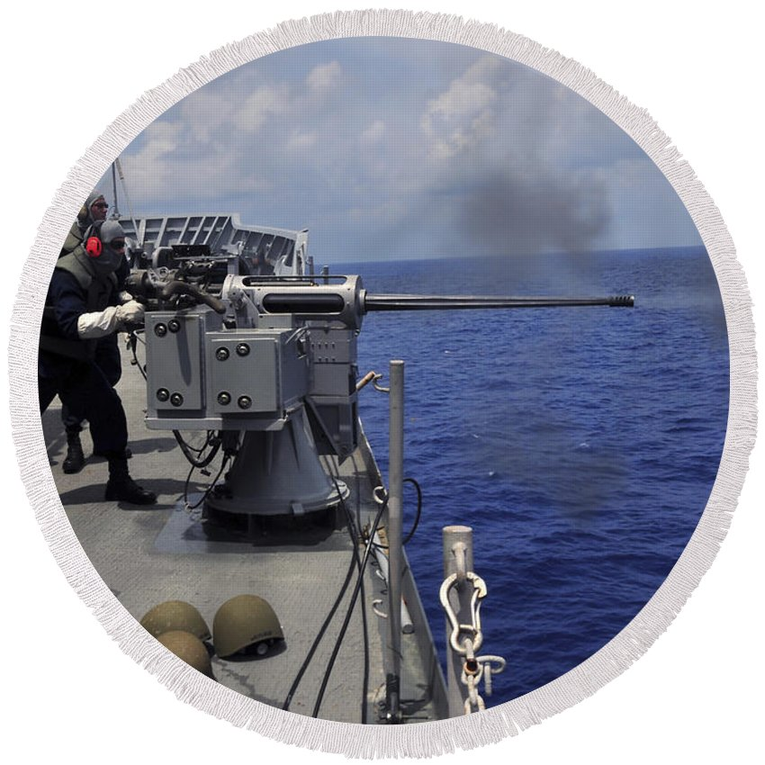 Submarine Tender Round Beach Towel featuring the photograph Gunner Fires A Mark 38 Machine Gun by Stocktrek Images