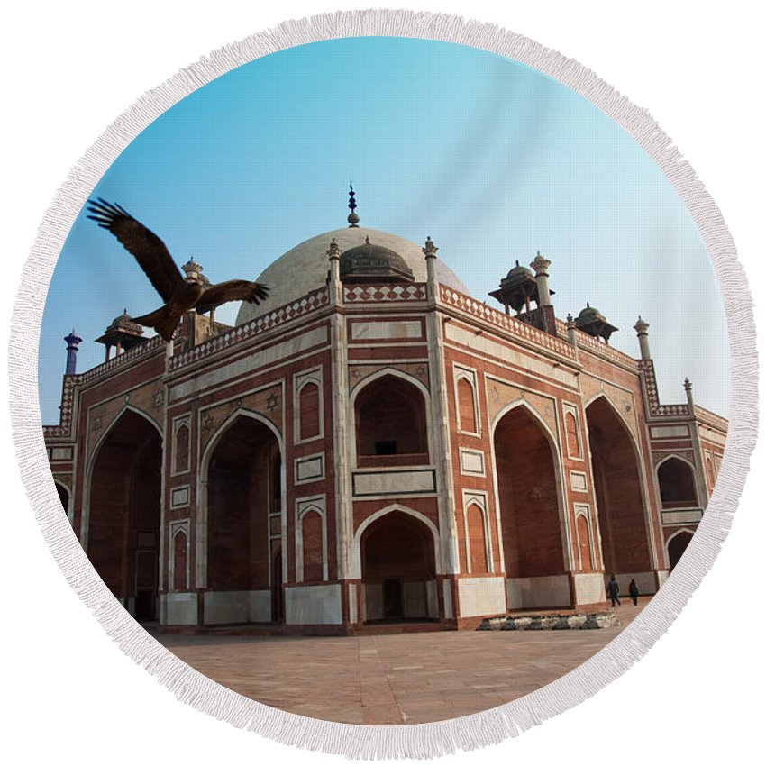 Tomb Round Beach Towel featuring the photograph Hawk Flying Next To Humayun Tomb Delhi by Ashish Agarwal