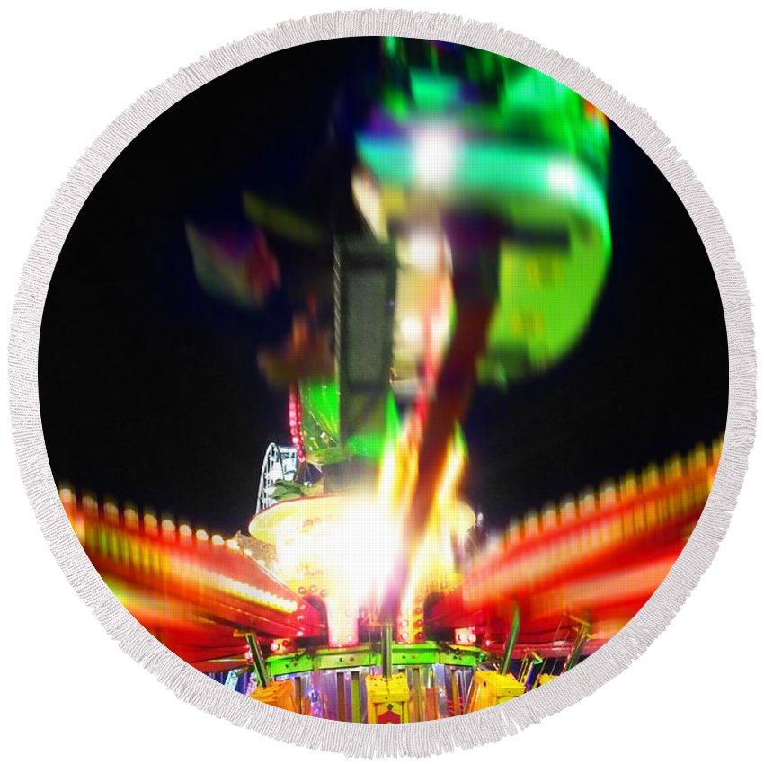 Fairground Ride At Night Round Beach Towel featuring the digital art Hoppity Hop Hop Hop by Charles Stuart