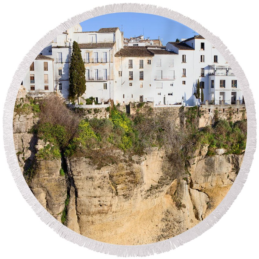 Ronda Round Beach Towel featuring the photograph Houses On A Cliff In Ronda Town by Artur Bogacki