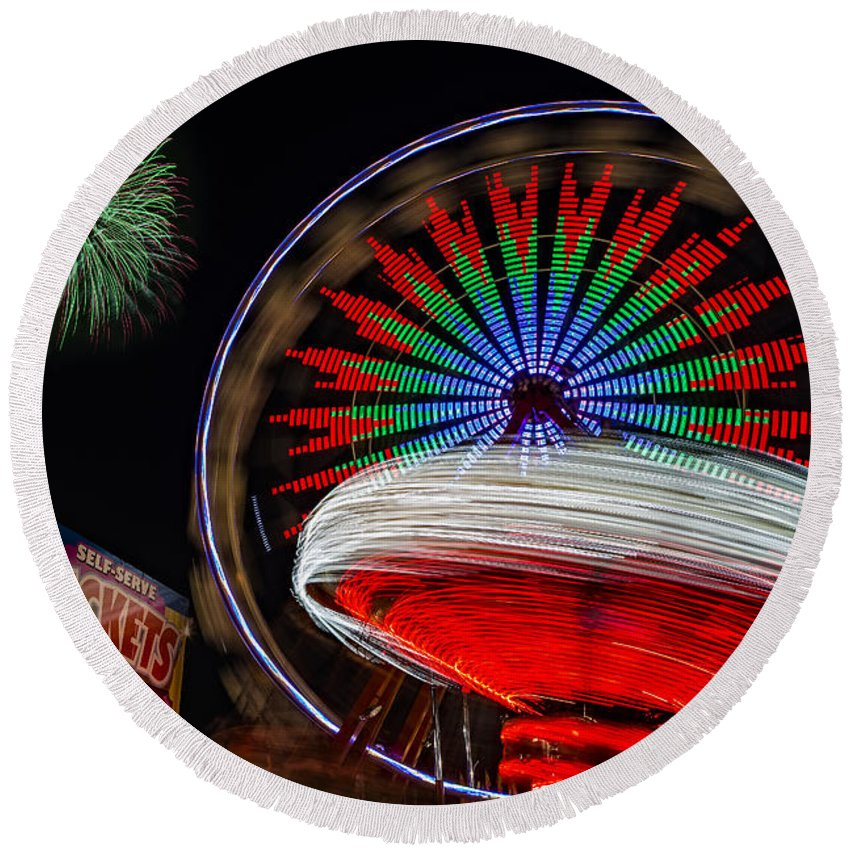 State Fair Round Beach Towel featuring the photograph In Motion by Susan Candelario