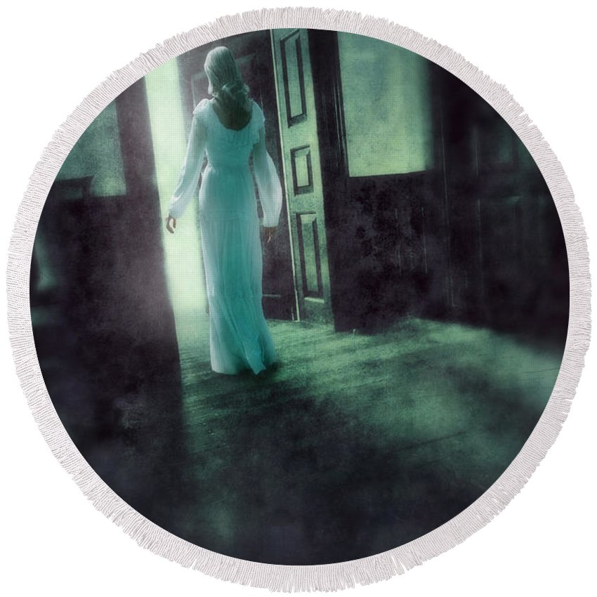 Woman Round Beach Towel featuring the photograph Lady In White Gown Walking Through A Mysterious Doorway by Jill Battaglia