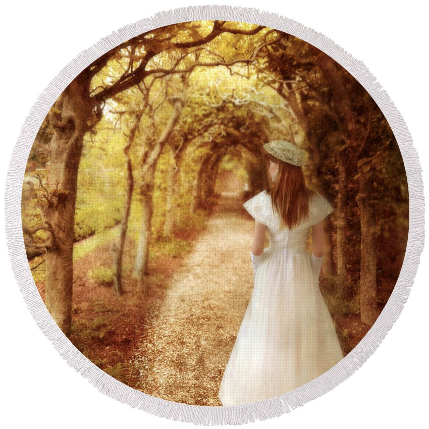 Woman Round Beach Towel featuring the photograph Lady Walking In Tree Tunnel In Garden by Jill Battaglia