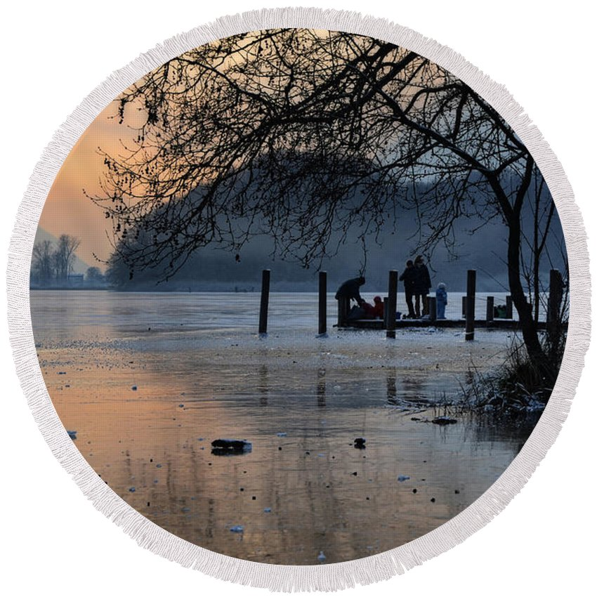 Frozen Round Beach Towel featuring the photograph Lake With Ice In Sunset by Mats Silvan