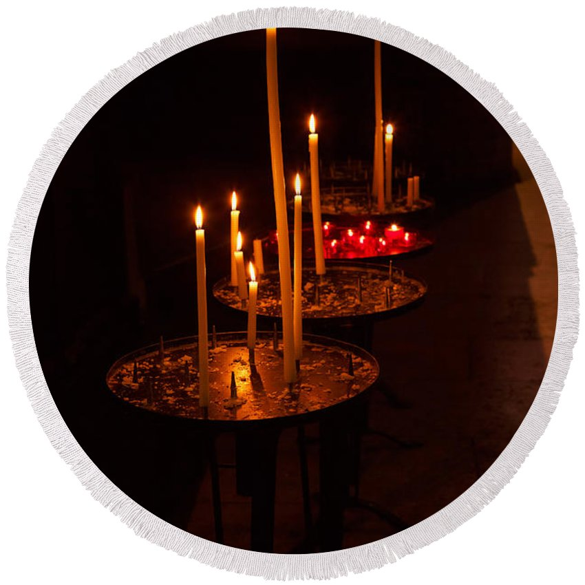 Candles Round Beach Towel featuring the photograph Lit Candles In A Church by Louise Heusinkveld