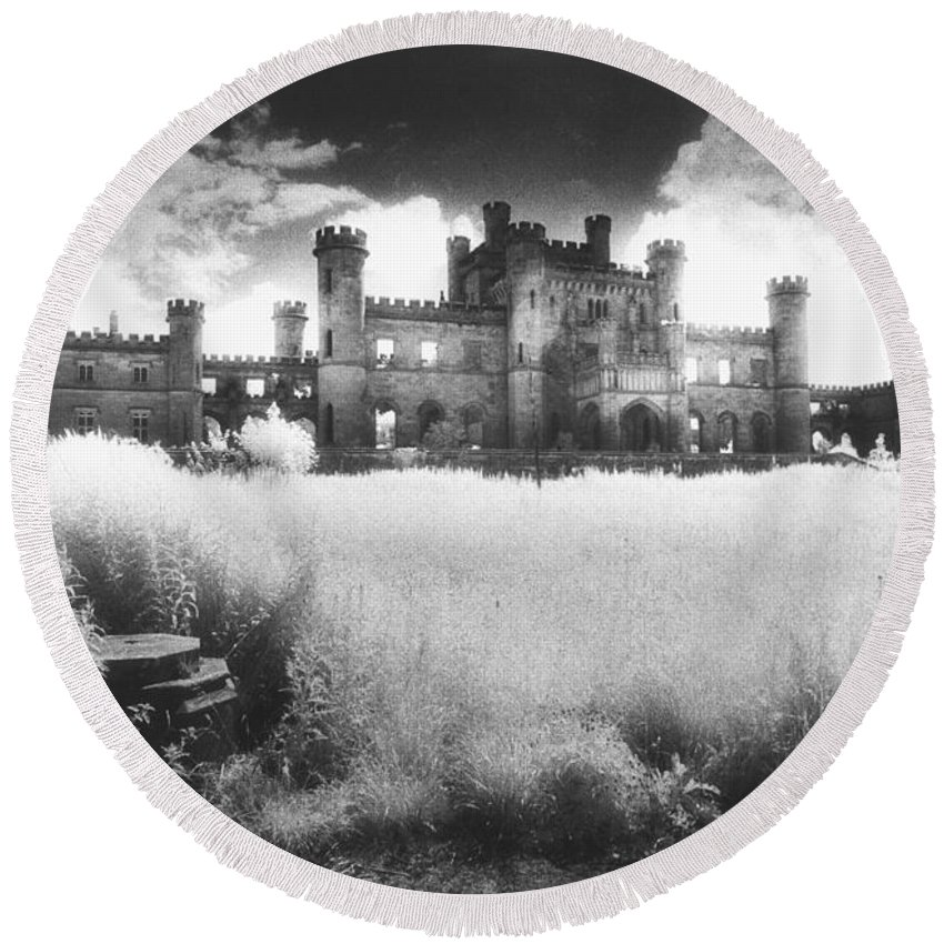 Castellated; Crenellated; Towers; Exterior; Architecture; English; Facade; Gothic; Ghostly; Atmospheric; Striking; Dramatic; Landscape; Eerie; Mysterious; Sinister Round Beach Towel featuring the photograph Lowther Castle by Simon Marsden