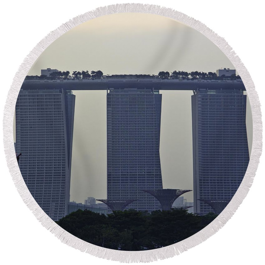 Admiral Cheng Ho Cruise Round Beach Towel featuring the photograph Marina Bay Sands As Seen From The Harbor Cruise by Ashish Agarwal