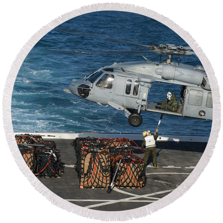 Military Round Beach Towel featuring the photograph Marines Attach Cargo To An Mh-60s Sea by Stocktrek Images