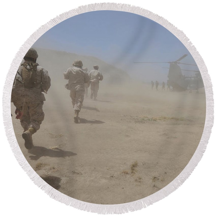 Marine Expeditionary Unit Round Beach Towel featuring the photograph Marines Move Through A Dust Cloud by Stocktrek Images