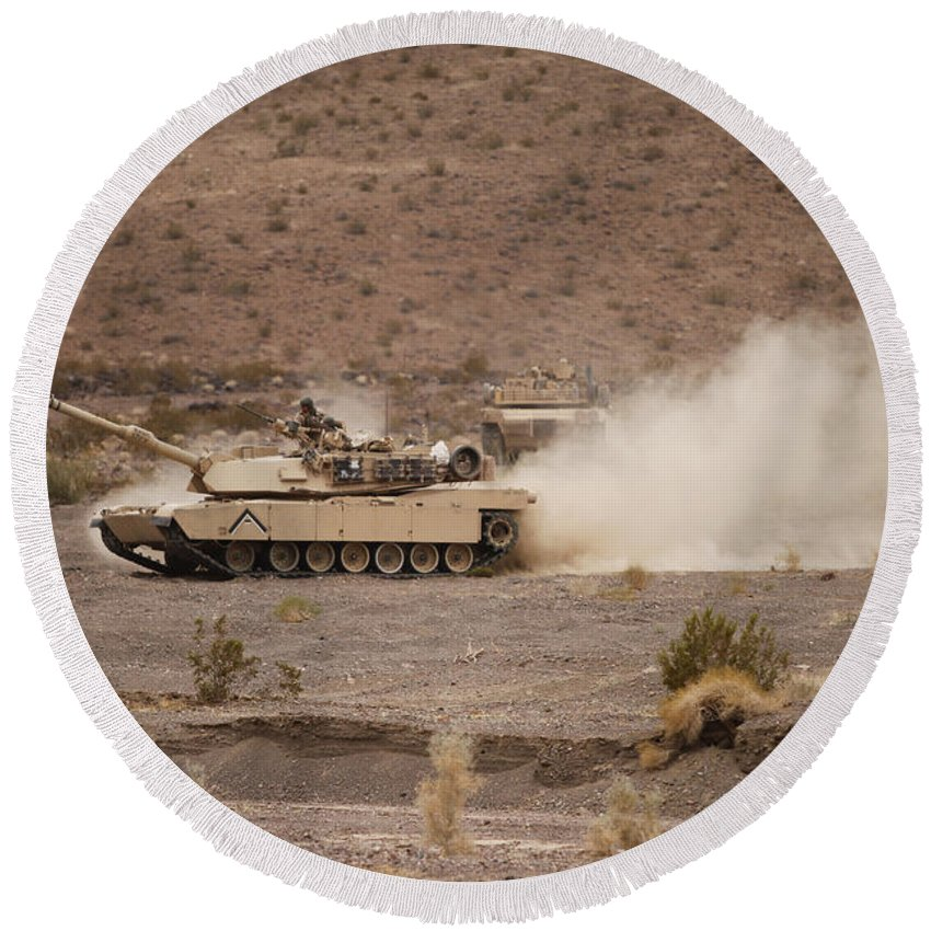 Military Round Beach Towel featuring the photograph Marines Roll Through The Combat Center by Stocktrek Images