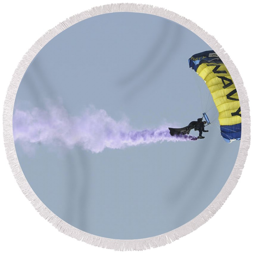 Leap Frogs Round Beach Towel featuring the photograph Member Of The U.s. Navy Parachute by Stocktrek Images