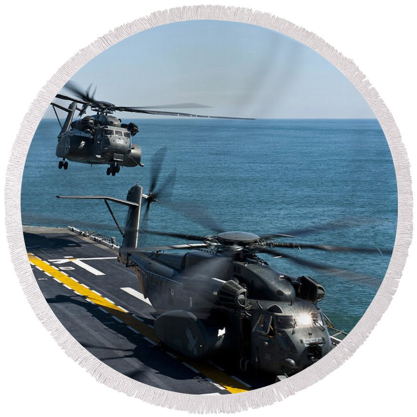 Uss Wasp Round Beach Towel featuring the photograph Mh-53e Sea Dragon Helicopters Take by Stocktrek Images