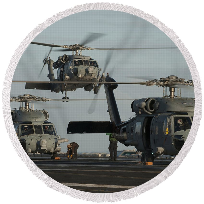 Warship Round Beach Towel featuring the photograph Military Helicopters Land On The Flight by Stocktrek Images
