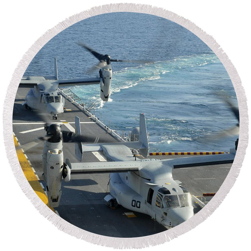 No People Round Beach Towel featuring the photograph Mv-22 Osprey Aircraft Land Aboard Uss by Stocktrek Images