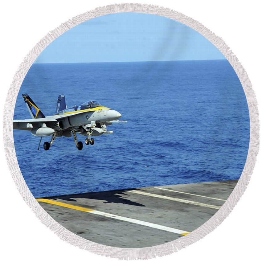 Air Force Round Beach Towel featuring the photograph N Fa-18c Hornet Lands Aboard by Stocktrek Images