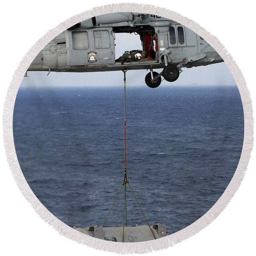 South China Sea Round Beach Towel featuring the photograph N Mh-60s Sea Hawk En Route by Stocktrek Images