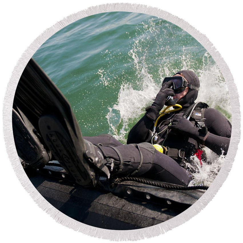 Operation Clean Sweep Round Beach Towel featuring the photograph Navy Diver Dives Into San Diego Bay by Stocktrek Images