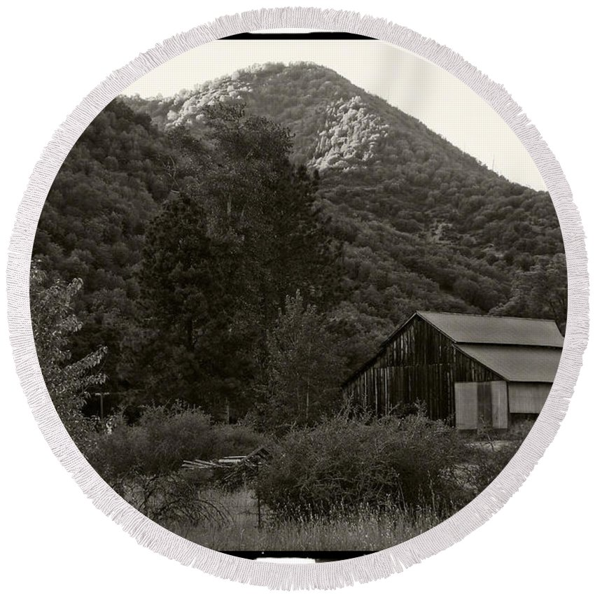 Old Round Beach Towel featuring the photograph Old Barn In Black And White by Mick Anderson